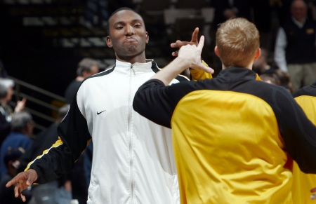 Iowa's Cyrus Tate jokes around with teammate J.R. Angle before their  Big Ten Conference basketball game against Wisconsin Wednesday, Jan. 21, 2009 at Carver-Hawkeye Arena in Iowa City. Iowa won the game 73-69 in overtime. (Brian Ray/The Gazette)