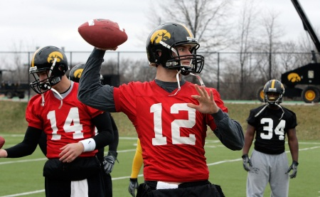 Iowa quarterbacks Ricky Stanzi (12) and John Wienke (14) workout during the team's practice Wednesday, March 25, 2009 at the Kenyon Football Practice Facility on the University of Iowa campus in Iowa City.  (Brian Ray/The Gazette)