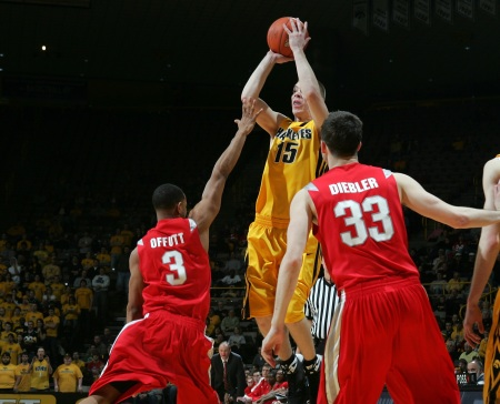 Iowa's Devan Bawinkel (15) pulls up for a three-point shot over Ohio State's Walter Offutt (3) and Jon Diebler (33) during the second half of their college basketball game Tuesday, March 3, 2009 at Carver-Hawkeye Arena in Iowa City. Bawinkel went 8 for 13 from behind the three-point line and Iowa lost the game 58 to 60.  (Brian Ray/The Gazette)