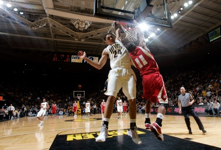 Iowa's Aaron Fuller (24) blocks a shot by Wisconsin's Jordan Taylor (11) during the second half of their Big Ten Conference basketball game Wednesday, Jan. 21, 2009 at Carver-Hawkeye Arena in Iowa City. The Wisconsin bench was called for a technical foul after the play.(Brian Ray/The Gazette)