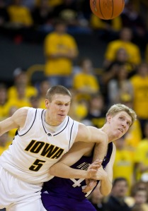 Iowa's Matt Gatens (5) fights for a loose ball with Northwestern's Kevin Coble during the first half of an NCAA college basketball game, Feb. 7, 2009, in Iowa City, Iowa. (AP Photo/Charlie Neibergall)