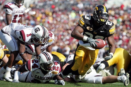 Former Iowa running back Shonn Greene blasts through South Carolina's defense for a touchdown in the 2009 Outback Bowl in Tampa, Fla. (Jonathan D. Woods/The Gazette)