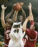 Iowa's Cyrus Tate leaps for the basket between Tom Pritchard (left) and Matt Roth (right) of Indiana during the game at Carver-Hawkeye Arena in Iowa City on Saturday, January 3, 2009. (Cliff Jette/The Gazette)