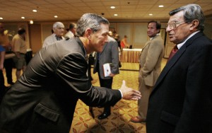 Iowa Coach Kirk Ferentz, left, reaches over to shake hands with Penn State Coach Joe Paterno on Aug. 1, 2006, at the Big Ten Conference football media day in Chicago. Paterno, 81, has won two national titles at Penn State. (AP Photo/M. Spencer Green)