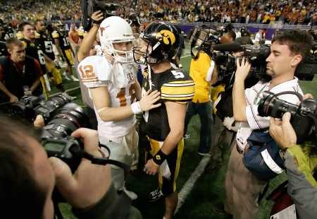 Iowa quarterback Drew Tate (5) congratulates  Texas quarterback Colt McCoy (12) following Iowa's 26-24 loss in the  Alamo Bowl on Dec. 30, 2006 in San Antonio.
