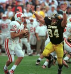 Iowa's Jared DeVries haunts Wisconsin quarterback Mike Samuel (10) and brings him down for a 6-yard loss in the first quarter. DeVries had three sacks costing the Badgers 18 yards on Oct. 24, 1998.