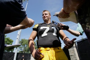 Iowa offensive lineman Seth Olsen talks to reporters during Iowa's annual football media day, Aug. 4, 2008, in Iowa City, Iowa. (AP Photo/Charlie Neibergall)