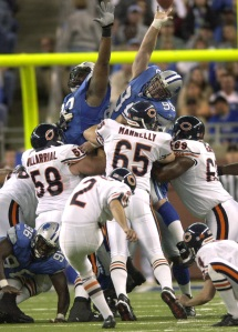 Detroit's Jared DeVries (95) tips Chicago Bears kicker Paul Edinger's field-goal attempt in the second quarter in Detroit on Nov. 9, 2003. The field-goal attempt was no good. (AP Photo/Paul Sancya)