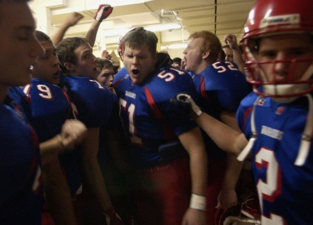 Rob Bruggeman (at center) leads Cedar Rapids Washington out of the locker room of the UNI-Dome prior to the Class 4A Championship game against West Des Moines Valley in Cedar Falls on Nov. 21, 2003.