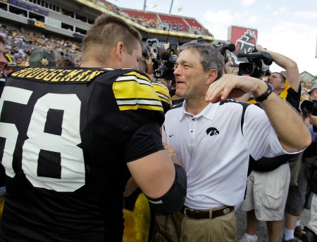 Iowa Coach Kirk Ferentz, right, hugs center Rob Bruggeman after the Hawkeyes beat South Carolina 31-10 in the Outback Bowl on Jan. 1, 2009 in Tampa, Fla. (AP Photo/Chris O'Meara)