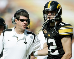 Iowa offensive coordinator Ken O'Keefe gives instructions to quarterback Ricky Stanzi during the third quarter of the Outback Bowl at Raymond James Stadium on Jan. 1, 2009, in Tampa, Fla. Iowa beat South Carolina, 31-10. (Jim Slosiarek/The Gazette)