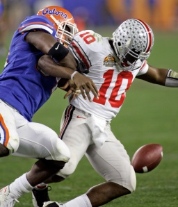 Florida defensive end Jarvis Moss (94) forces a fumble against Ohio State quarterback Troy Smith (10) in the BCS title game at Glendale, Ariz., on Jan. 8, 2007. (AP Photo/Ted S. Warren)