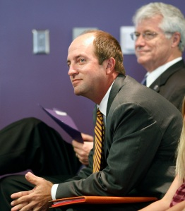 Troy Dannen, left, waits to speak at a press conference where he is officially announced as the new athletic director at Northern Iowa, June 3, 2008 in Cedar Falls, Iowa. (AP Photo)