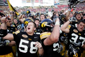 Iowa center Rob Bruggeman leads the team and fans in the fight song after their 31-10 victory over the South Carolina Gamecocks at the Outback Bowl at Raymond James Stadium in Tampa Bay, Fla., on Jan. 1, 2009. (Jonathan D. Woods/The Gazette)