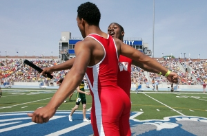 Cedar Rapids Washington's Ronnie Henderson chest bumps teammate Keenan Davis after their relay team won the 4A boys 4x200 meter relay during the 2009 Class 4A state track meet Friday, May 22, 2009 at Drake Stadium in Des Moines.  (Brian Ray/The Gazette)
