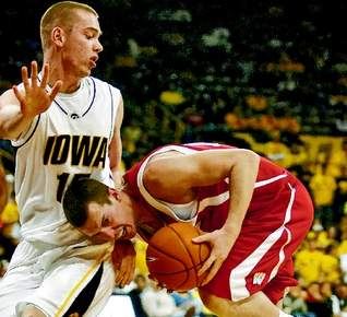 Iowa guard Devan Bawinkel guards an Indiana player on Jan. 3, 2009 at Carver-Hawkeye Arena.