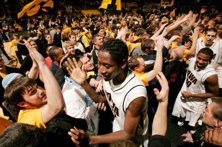 Iowa's Kurt Looby is congratulated by a floor full of fans as the Hawkeyes leave the court after defeating Michigan State at Carver-Hawkeye Arena in Iowa City on Jan. 12, 2008. (Cliff Jette/The Gazette)