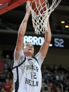 Sioux City Heelan's Zach McCabe dunks the ball in his team's victory over Carroll in a Class 3A semifinal game at the Iowa boys high school basketball tournament,  Thursday, March 12, 2009, in Des Moines, Iowa. (AP Photo/Steve Pope)